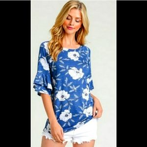 First Love blue floral top with ruffled sleeves